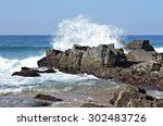A Large Waves Crashes Into A...