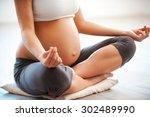meditating on maternity. close... | Shutterstock . vector #302489990