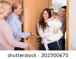 happy aged couple meeting kids... | Shutterstock . vector #302500670