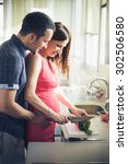 young couple cooking together... | Shutterstock . vector #302506580