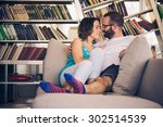 young romantic couple sitting... | Shutterstock . vector #302514539