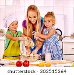 Mother And Two Daughter Baking...