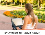 young woman using tablet ... | Shutterstock . vector #302573024