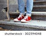 young skateboarder in gumshoes... | Shutterstock . vector #302594048