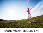 young woman enjoying summer sun | Shutterstock . vector #302609174
