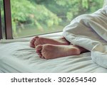 woman feet on the bed | Shutterstock . vector #302654540