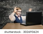 kid looking at laptop  child... | Shutterstock . vector #302693624