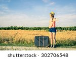 girl hitchhiking on his journey ...   Shutterstock . vector #302706548