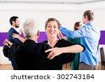 group of people dancing in... | Shutterstock . vector #302743184