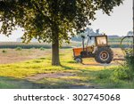 An Old Tractor Is Resting Afte...