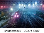 trains at night in a fog. the... | Shutterstock . vector #302754209