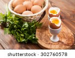 boiled eggs on a wooden... | Shutterstock . vector #302760578