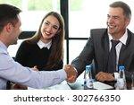 business people shaking hands ...   Shutterstock . vector #302766350