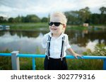 photo of little gentleman with... | Shutterstock . vector #302779316