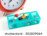 Small photo of Medicine dose box isolated on white background - Daily dosage of medication in blue pill dispenser