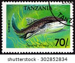 "Small photo of TANZANIA - CIRCA 1993: A stamp printed in Tanzania from the ""Sharks "" issue shows African angelshark (Squatina africana), circa 1993."