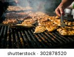 grilling  meat with barbecue... | Shutterstock . vector #302878520
