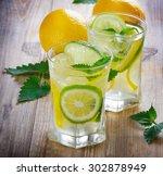 glasses of lemon water with... | Shutterstock . vector #302878949