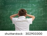 funny schoolboy  holding book... | Shutterstock . vector #302903300