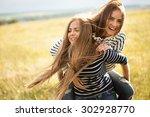 Two Young Women Making Fun...