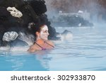 Woman Relaxing In Geothermal...