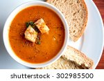 a bowl of fresh tomato soup in... | Shutterstock . vector #302985500