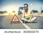 man with reflective vest call... | Shutterstock . vector #303003374