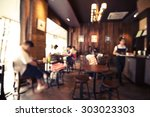 Stock photo coffee shop cafe blurred background with bokeh image 303023303