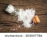 salt sprinkled on wooden table | Shutterstock . vector #303047786