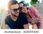 portrait of two friends using... | Shutterstock . vector #303055340
