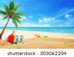 summer accessories on sandy... | Shutterstock . vector #303062204