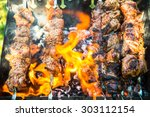 meat cooked on the grill | Shutterstock . vector #303112154