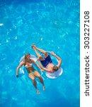 couple outside relaxing in... | Shutterstock . vector #303227108