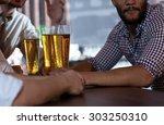 beer evening. close up of beer... | Shutterstock . vector #303250310