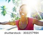 african woman beach happiness... | Shutterstock . vector #303257984