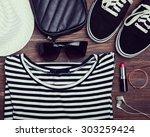 modern girl outfit on wooden... | Shutterstock . vector #303259424