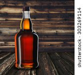 whiskey bottle on wood table | Shutterstock . vector #303269114