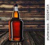 whiskey bottle on wood table | Shutterstock . vector #303269114