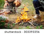 roast sausages over a fire in... | Shutterstock . vector #303393356