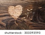 Heart Carved Into Wooden Plank