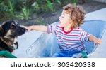portrait of 1 year old baby boy ...   Shutterstock . vector #303420338