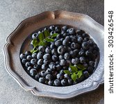 Small photo of Blueberries on pewter plate