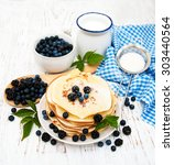 pancakes with fresh berries ... | Shutterstock . vector #303440564