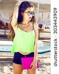 indoor fashion portrait of... | Shutterstock . vector #303443909