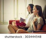 girls sitting on the sofa... | Shutterstock . vector #303444548