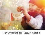 Little Cute Girl Giving Cookie...