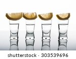 photo of four shots of vodka... | Shutterstock . vector #303539696
