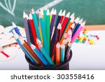 colorful pencils of red yellow... | Shutterstock . vector #303558416