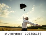 Small photo of Happy Successful Young Businessman Throwing His Coat in the Air for being Free of Something with Wide Open Arms at the Field During Sunset.