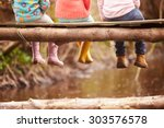 close up of children's feet... | Shutterstock . vector #303576578